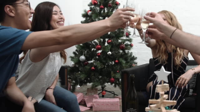 Christmas: A group of friends toasting with champagne celebrating Christmas