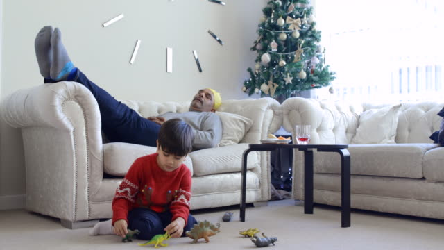 christmas afternoon - lying on back stock videos & royalty-free footage