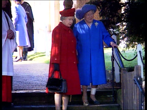Christmas at Sandringham/ Christmas message 1315 Norfolk Sandringham MS Queen Mother with bandaged leg and using walking stick down steps with Queen...