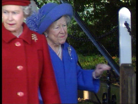 stockvideo's en b-roll-footage met christmas at sandringham/ christmas message 1700 norfolk ms queen mother using walking sticks out of church with prince harry and prince philip cms... - 1995