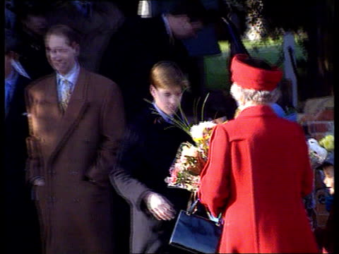 Christmas at Sandringham/ Christmas message 2155 Norfolk Sandringham MS Queen Mother using walking sticks out of church with Prince Harry and Prince...