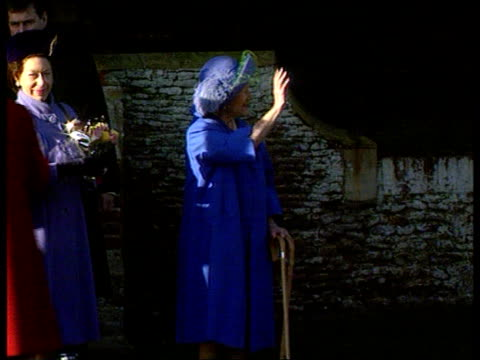 Christmas at Sandringham/ Christmas message EXT Sandringham MS Queen and Queen Mother as Queen moves away and Queen Mother waves and leans on two...