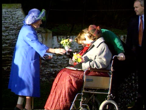 christmas at sandringham/ christmas message ms side woman in wheelchair hands flowers to queen mother tx 251295/1315pm - queen dowager stock videos and b-roll footage