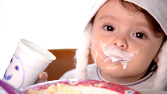 Christmas Baby Girl Drinking Yogurt