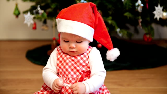 christmas baby girl plays with wrapping paper - christmas wrapping paper stock videos & royalty-free footage
