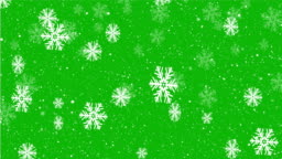 Christmas background design of slow motion snowflake and snow falling on green screen