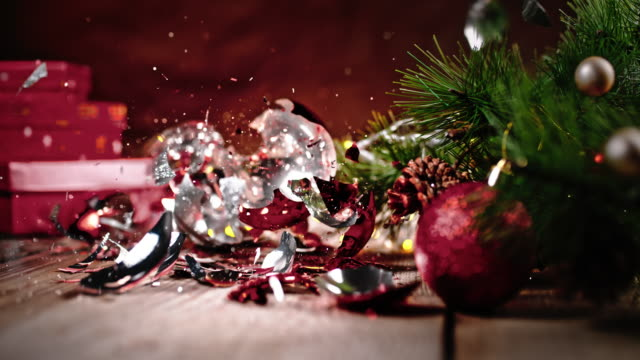 slo mo christmas balls falling on the floor, crushed into pieces - christmas decoration stock videos & royalty-free footage