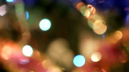 Christmas Balls on Christmas Tree. Christmas and New Year Decoration. Abstract Blurred Bokeh Holiday Background. Blinking Garland.