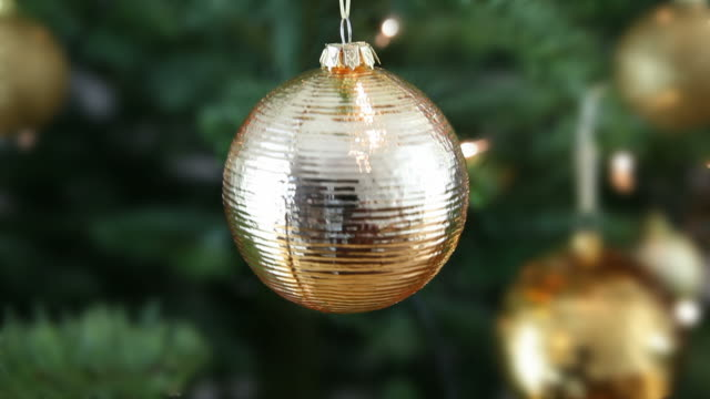 Christmas bauble on a tree, shaking.
