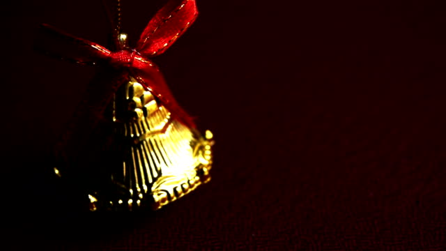 christmas bell on red background - ring stock videos and b-roll footage