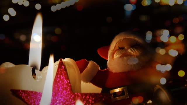 christmas candle and red baubles - bugtiger stock videos and b-roll footage