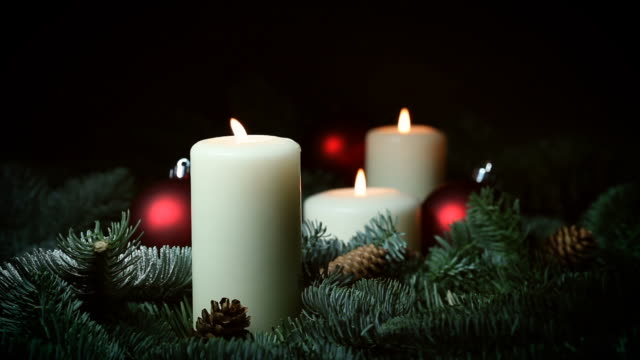 christmas candles and red baubles - three objects stock videos & royalty-free footage