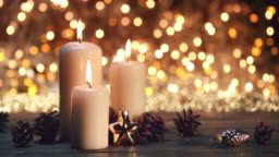 Christmas candles on rustic wooden table