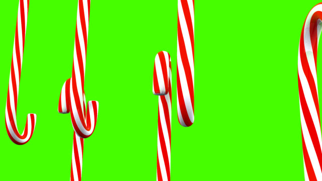 3d christmas candy canes spinning around - candy cane stock videos & royalty-free footage