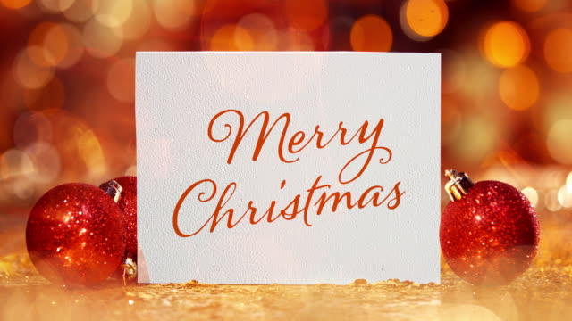 christmas card with christmas ball and ornament on glitter - text stock videos & royalty-free footage