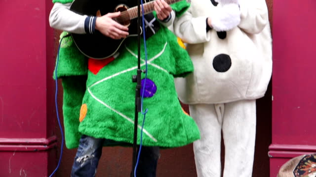 christmas charity buskers - showing off stock videos and b-roll footage