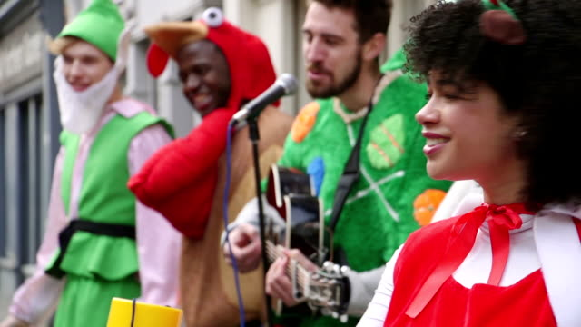 christmas charity buskers - mrs claus stock videos and b-roll footage