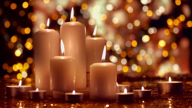 Christmas composition with burning white candles