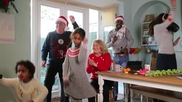 christmas dancing with the family - genderblend stock videos & royalty-free footage