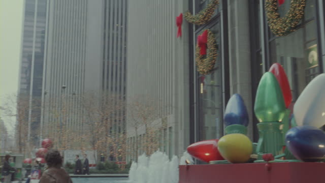 Christmas decoration adorning the facade and fountain of Radio City Music Hall.