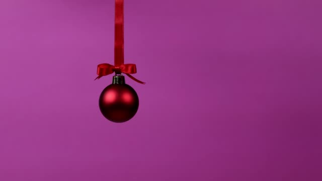 christmas decoration ball falling from the top of the frame - decor stock videos & royalty-free footage