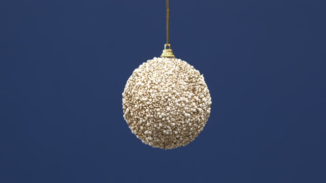 vídeos de stock e filmes b-roll de christmas decoration ball for new year tree hanging on blue background. - cartão de ano novo