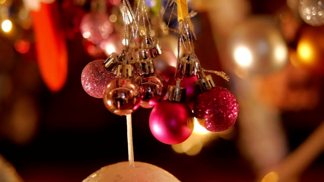 christmas decoration. beautiful christmas ornaments with sparkler stick in background. - isolated colour stock videos & royalty-free footage