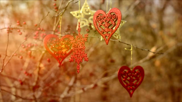 christmas decoration hanging on tree, heart, christmas star - hand on heart stock videos & royalty-free footage