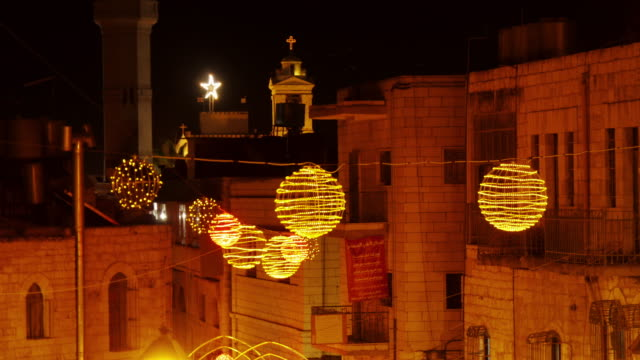 christmas decoration in bethlehem, westbank, palestine. wide shot at night.. - spoonfilm stock-videos und b-roll-filmmaterial