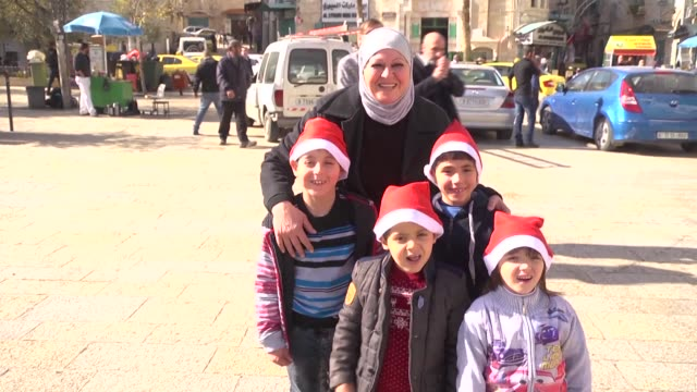 christmas decorations adorn the west bank town of bethlehem where a tree and a nativity scene have been set up on the manger square near the church... - church of the nativity stock videos and b-roll footage