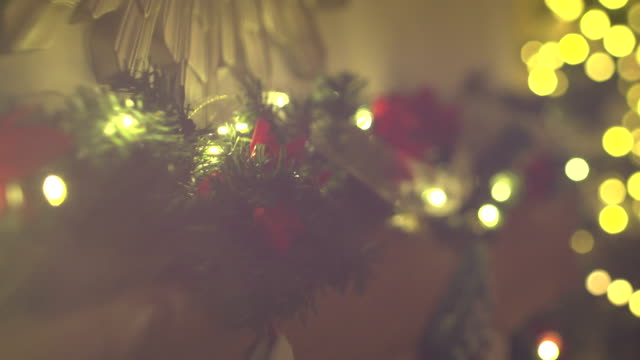 4k christmas decorations and christmas tree / garland - soft focus stock videos and b-roll footage
