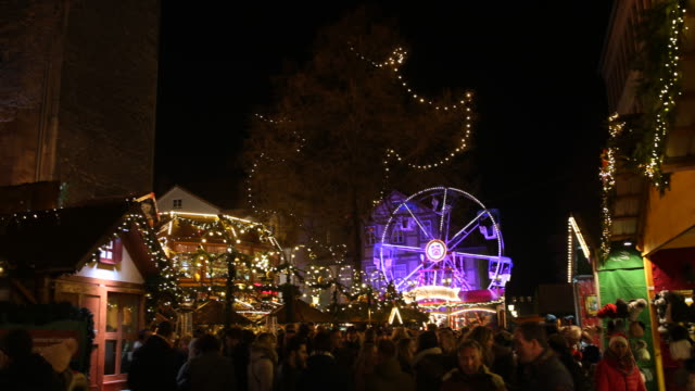 christmas decorations and lighting over the christmas market in the background a illuminated ferris wheel can be seen visitors are enjoying arts and... - advent calendar stock videos & royalty-free footage