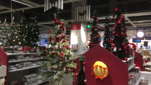 christmas decorations and ornaments are exhibited and sold in an ikea store - christmas present stock videos & royalty-free footage