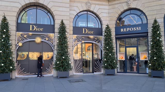 christmas decorations are displayed outside as people walk by the 'dior' store on place vendome on november 28, 2020 in paris, france. the reopening... - place vendome stock videos & royalty-free footage