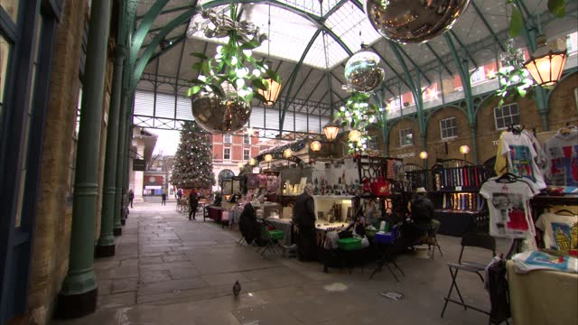 christmas decorations at covent garden market; england: london: covent garden: int various shots market reflected in giant bauble various of giant... - branch stock videos & royalty-free footage
