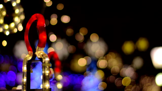 christmas decorations glowing on a black background - carol singer stock videos & royalty-free footage