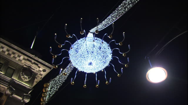 christmas decorations hang over oxford street in london. - oxford street stock-videos und b-roll-filmmaterial