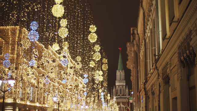 christmas decorations hanging over the street in the center of moscow, russia - red square stock videos & royalty-free footage