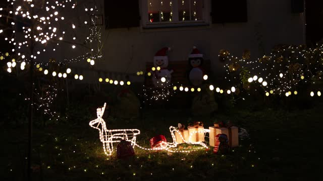 christmas decorations light up an apartment and garden in the district zehlendorf during the second wave of the coronavirus pandemic on december 14,... - star shape stock videos & royalty-free footage