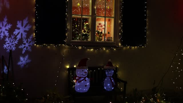 christmas decorations light up an apartment and garden in the district zehlendorf during the second wave of the coronavirus pandemic on december 14,... - cosy stock videos & royalty-free footage