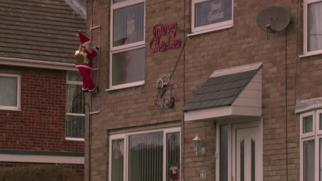 christmas decorations on a house, uk - male likeness stock videos & royalty-free footage