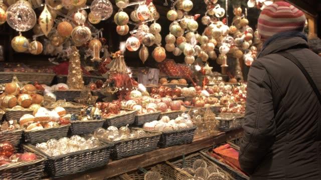 christmas decorations stall, christmas market, rathausplatz, vienna, austria, europe - christmas market stock videos & royalty-free footage