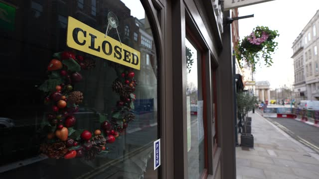 christmas decorations still on display on a closed shop as spring approaches on february 24, 2021 in london, england. the ons figures released today... - decoration stock videos & royalty-free footage