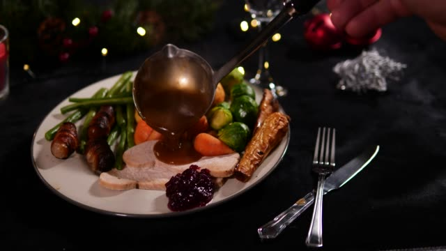 4K DOLLY: Christmas Dinner Plate / Lunch with gravy poured