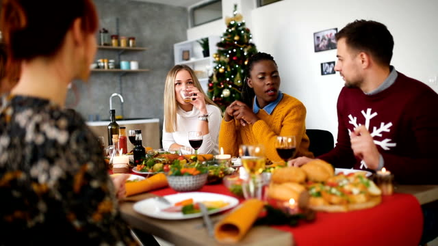 christmas dinner with friends and family - december stock videos & royalty-free footage