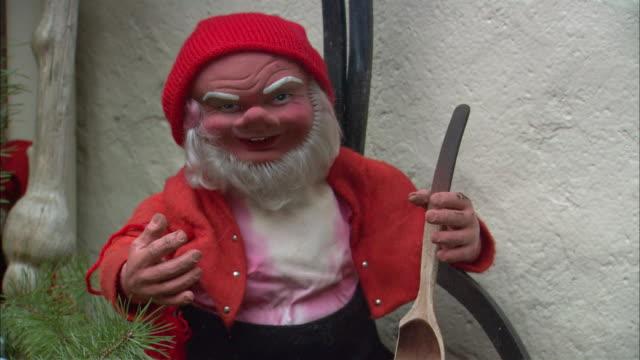 cu tu td christmas elf figurine with pan and ladle / drobak, akershus, norway - エルフ点の映像素材/bロール