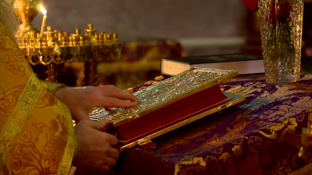 christmas eve in orthodox church - closing holy bible - bible stock videos & royalty-free footage