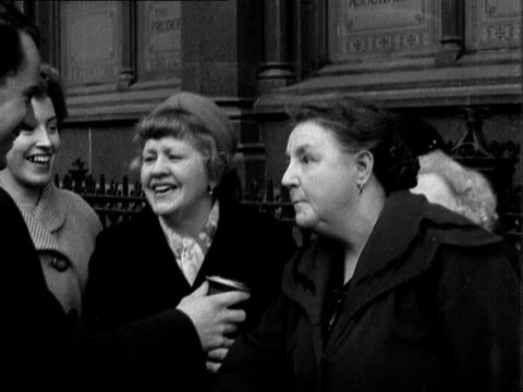 last minute shoppers and celebrations england london birmingham ext group of women along laden with christmas shopping laughing as look in shop... - bbc archive stock-videos und b-roll-filmmaterial