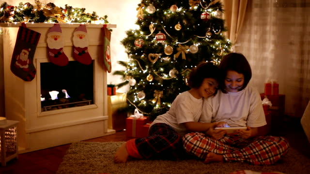 christmas evening - christmas stocking stock videos and b-roll footage