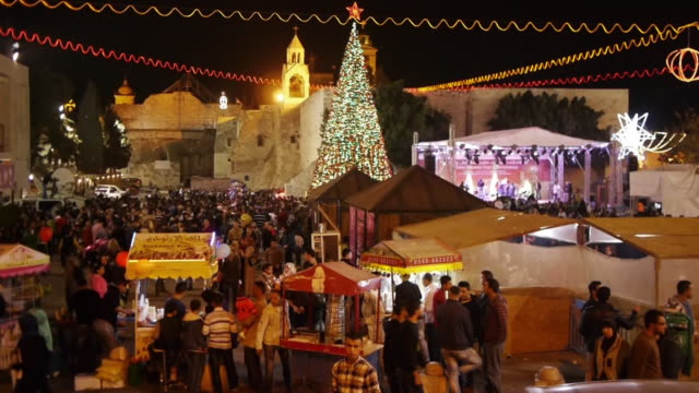 christmas fair at manger square and church of the nativity in bethlehem, westbank, palestine. narrow shot. - church of the nativity stock videos and b-roll footage